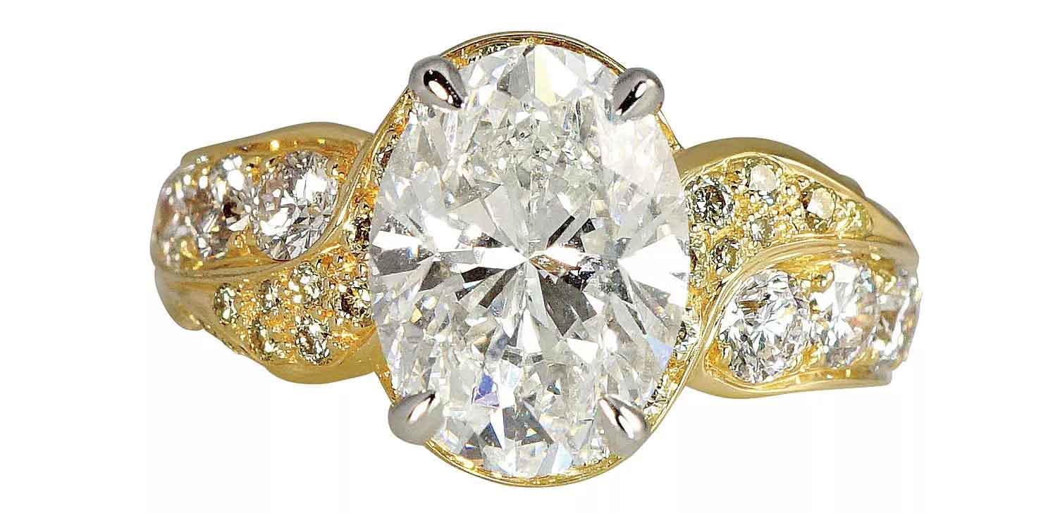 Jill custom engagement ring in 18k yellow gold and platinum with a 3.52 ct. oval center diamond
