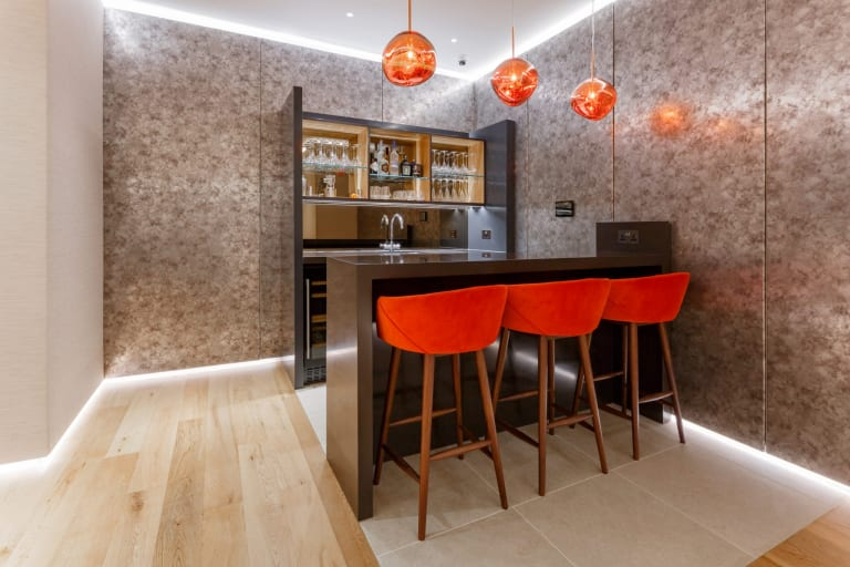The Lounge Includes A Bar Area For Clients To Enjoy.