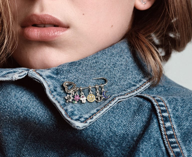 Pandora Me Welcomes Two New Charm Carriers, Including A Safety Pin Brooch.